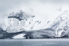 Mountains, rocks, ice, snow and mist Royalty Free Stock Photos