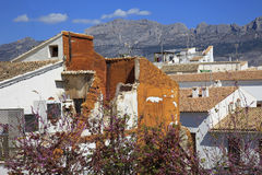 Mountains and rooftops Costa Blanca Spain. Mountains overlook the rooftops of houses on the Costa Blanca Spain Stock Photos