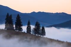 Mountains rural landscape at foggy sunrise Royalty Free Stock Image