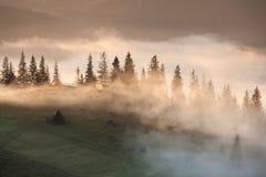 Mountains rural landscape at foggy sunrise Stock Photo