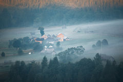 Mountains rural landscape at misty sunrise Royalty Free Stock Image