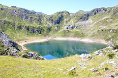 Mountains and Saliencia& x27;s lake full of water in Asturias Stock Image