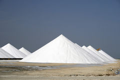 Mountains of salt. Big heaps of salt at salt factory in the Caribbean Royalty Free Stock Photo
