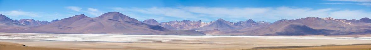 Mountains and salt pan in Eduardo Avaroa Reserve, Bolivia Stock Photos
