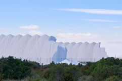 Mountains of salt in Spain. View to salt factory in Santa Pola, Alicante province, Spain. April 2018 Stock Photos