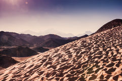 Mountains and sand in the Arabian desert Royalty Free Stock Image