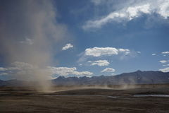 Mountains and sand storm in Tibet Royalty Free Stock Photo