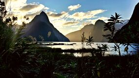 Mountains on Sea during Day Time Royalty Free Stock Images