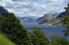Mountains and sea, Scandinavia. Scandinavian fjord in Norway with beautiful mountains, trees clouds and sky in pure nature stock photo