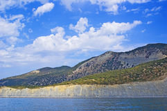 Mountains, sea and sky. View of a sea coast and mountain range Royalty Free Stock Photography