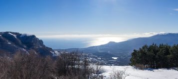 Mountains, sea, sky, winter, snow. Coastal winter landscape with mountains, sea, sky, winter and snow Stock Photography