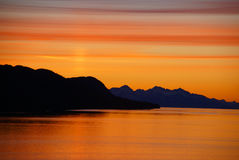 Mountains and sea - sunset & alpineglow Stock Photo