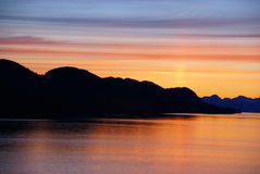 Mountains and sea - sunset & alpineglow Stock Photography