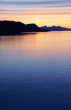 Mountains and sea - sunset & alpineglow Royalty Free Stock Images