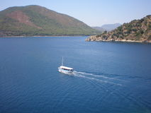Mountains and sea of Turkey. Boat on the sea in Turkey among the mountains stock images