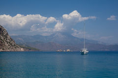 Mountains and sea and yacht Stock Images