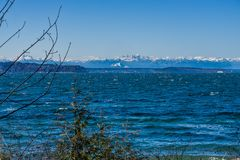 Mountains From Seahurst Beach 2. A view of the Olympic Mountains from Seahurst Beach Park in Burien, Washington royalty free stock image