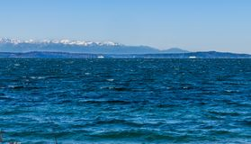 Mountains From Seahurst Beach 3. A view of the Olympic Mountains from Seahurst Beach Park in Burien, Washington stock photography