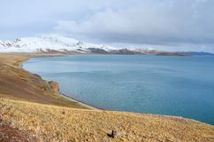 Mountains on the shore of lake Rakshas Tal Langa-Tso in summer in cloudy weather.  stock photo