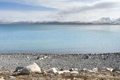 Mountains on the shore of lake Rakshas Tal Langa-Tso in summer in cloudy weather.  royalty free stock photo