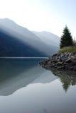 Mountains and shoreline of lake stock photo