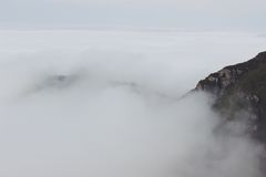 Mountains shrouded in cloud and mist