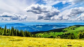 The mountains of the Shuswap highlands viewed a hiking trail on Tod Mountain near the alpine village of Sun Peaks,British Columbia. The mountains of the Shuswap stock images