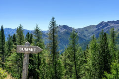 Mountains with sign. Sign summit with mountains in the background royalty free stock photo