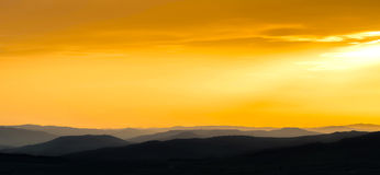 Mountains silhouette at sunset Royalty Free Stock Image
