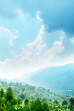 Mountains and sky. A picturesque view of beautiful green mountains under cloudy blue sky Stock Image