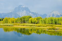 Mountains, sky and fall colors reflected in lake Royalty Free Stock Photo