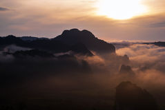 Mountains sky fog and sunrise Stock Photo