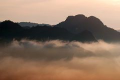 Mountains sky fog and sunrise Royalty Free Stock Photo