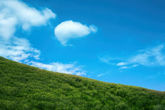 Mountains and sky. Mountains Forest Against Blue Sky Stock Photo