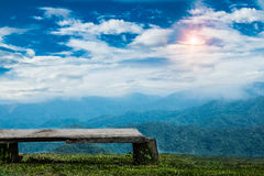 Mountains and sky and plane landscape with wooden desk space, Th. Ailand, Asia, Beauty world,focus on bench wooden. selective focus Royalty Free Stock Photography