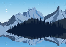 Mountains and sky reflection in a lake with forest Stock Image