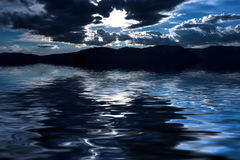 Mountains sky water reflection Royalty Free Stock Photos
