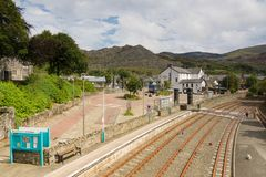 Blaenau Ffestiniog Wales. Mountains and slate mining spoil tips towering above the Welsh town of Blaenau Ffestiniog viewed from the railway station on Rawson stock photography