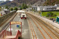 Blaenau Ffestiniog Wales. Mountains and slate mining spoil tips towering above the Welsh town of Blaenau Ffestiniog viewed from the railway station on Rawson stock images