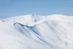 Mountains slopes covered with snow stock photography