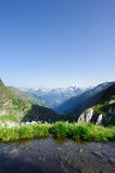 Mountains with small lake in the morning Royalty Free Stock Photo
