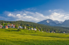 Mountains and small village in valley, Zabljak, Montenegro Stock Photos