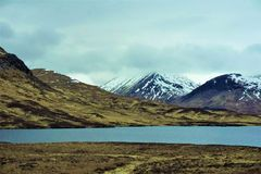 Mountains with smooth as a mirror Lochan na h-Achlaise, Bridge of Orchy royalty free stock images