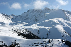 The mountains in the snow. Mountain top in the snow, the Tien Shan, Kyrgyzstan Royalty Free Stock Images