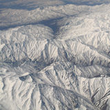 Mountains in the snow from the aircraft Royalty Free Stock Photo