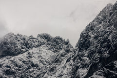 Mountains in the snow and clouds Royalty Free Stock Images