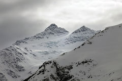 Mountains in snow in cloudy weather Royalty Free Stock Photos