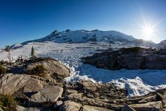 Mountains and Snow in Desolation Wilderness, California. Bright sunlight falls on high mountain scenery in California`s Desolation Wilderness, not far from Lake royalty free stock images