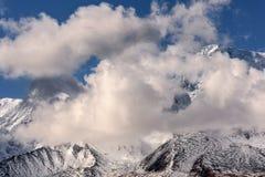 Mountains snow glacier clouds Stock Photos