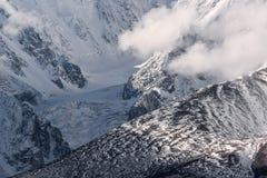 Mountains snow glacier clouds Stock Images